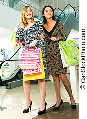 Two friends - Photo of beautiful girls in the mall on the...