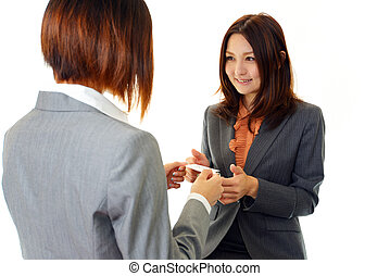 Women to exchange business cards
