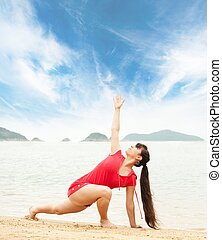 Beautiful brunette woman doing yoga exercise outdoors