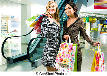 Rapt look - Image of young ladies looking at something with...