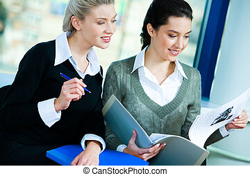 Females at work - Photo of two businesswomen sitting in the...