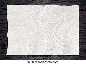 Wrinkled White paper on dark wood background