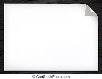 Blank white paper with corner curl on the dark wood...