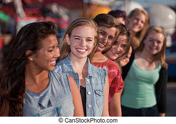 Smiling Teen Girls in Line - Smiling teenage girls standing...