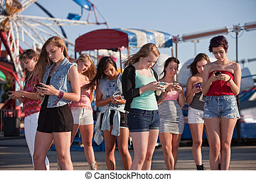 Teen Girls Text Messaging - Group of 8 teenage girls text...
