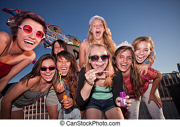 Group of Girls Blowing Bubbles