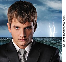 Ocean storm - Portrait of a serious businessman over dark...