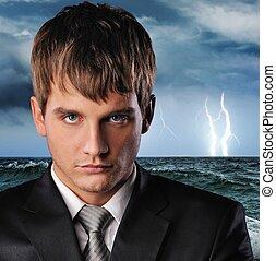Ocean storm - Portrait of a serious businessman over dark...