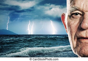 Ocean storm - Elderly man's face over stormy ocean...
