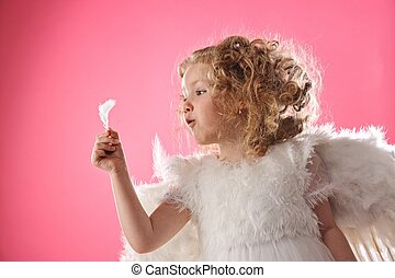 Beautiful angel girl holding a feather