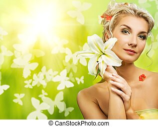 B5eautiful young woman with fresh flowers in her hair....