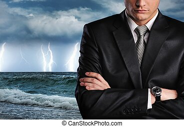 Ocean storm - Businessman over datk stormy sky