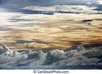 Clouds - The image of yellow clouds on a background of the...