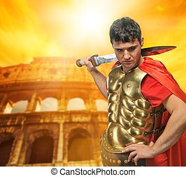 Colosseum Rome, Italy - Roman legionary soldier in front of...