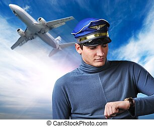Blue sky with fluffy clouds - Handsome pilot against blue...