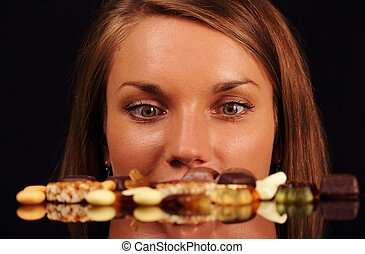 Young Woman looking on sweets on a table