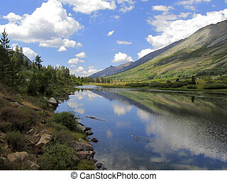 Reflection in Mountain Lake - Reflection of landscape and...