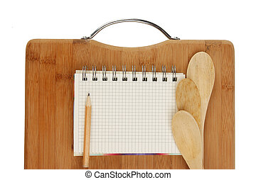 notebook for culinary recipes on a kitchen cutting board...