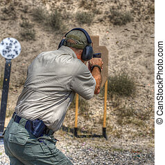 Moving shooter - Handgun shooter practicing while on the...