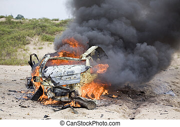 Smoldering car - Subcompact that has been exploded and...