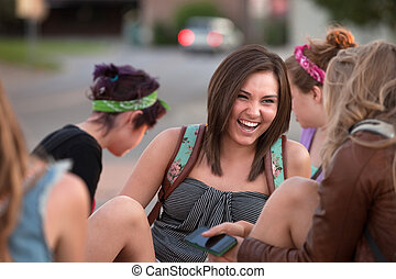 Cute Student Laughing with Friends - Beautiful teenage girl...