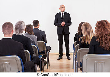 Portrait Of A Senior Manager Giving Presentation To His...