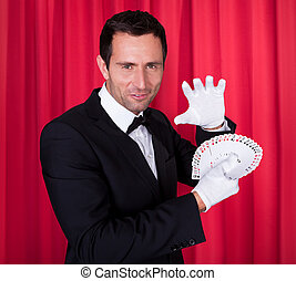 Portrait Of Magician Holding Fanned Deck Of Cards