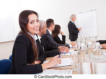 Young Business Woman Attending A Meeting With His Colleagues