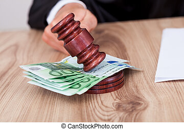Male Judge Striking The Gavel On Euro Note - Male Judge...