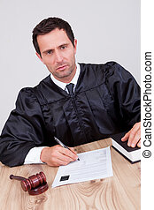 Male Judge In Courtroom - Male Judge Writing On Paper In...