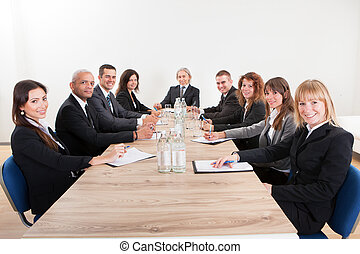 Portrait Of A Serious Business Men And Women Attending A...