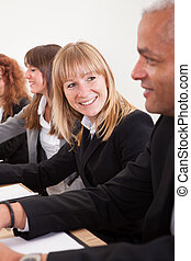 Business Woman In Meeting With Colleagues