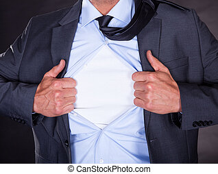 Superhero Tearing Off His Shirt On Black Background