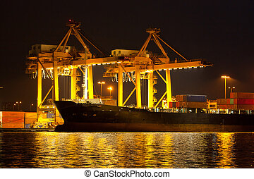 shipping port - Industrial shipping port on sunset in...