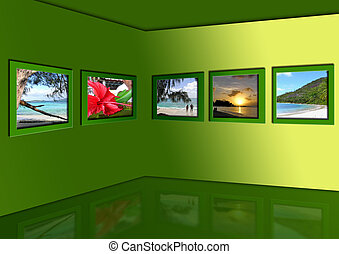 Photos of exotic tropics hang in a room on a green wall....