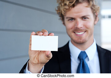 businessman holding business card - portrait of a handsome...