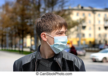 teenager in flu mask - teenager in the flu mask on the...