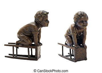 Antique bronze figurine depicting a boy sitting on a stool.