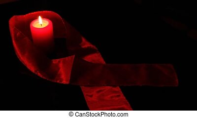 Ribbon - Red ribbon and candle as awareness for HIV