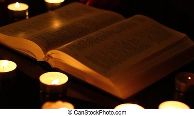 Reading a book by candles