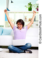 Winner - Portrait of ecstatic guy sitting with laptop and...