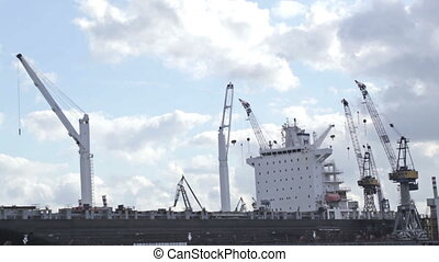 Cargo ship. - Cargo ship time lapse with fast moving clouds.
