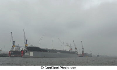 Cargo ship in Hamburg port. Fog.
