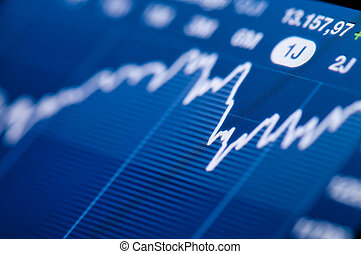Stock chart growth - Close-up of a stock market graph on a...