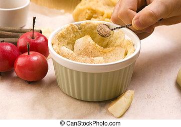 Detail of child hands making apple pie