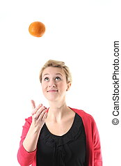 woman juggling with an orange