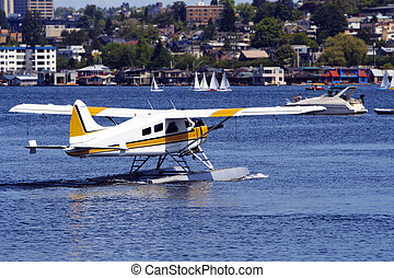 seaplane with boats in the background