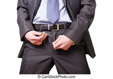 Young businessman pulling out a usb cable out of his pants -...