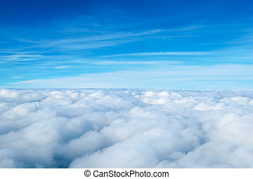 clouds. view from the window of an airplane flying in the...