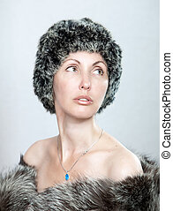 The young beautiful woman in a fur hat